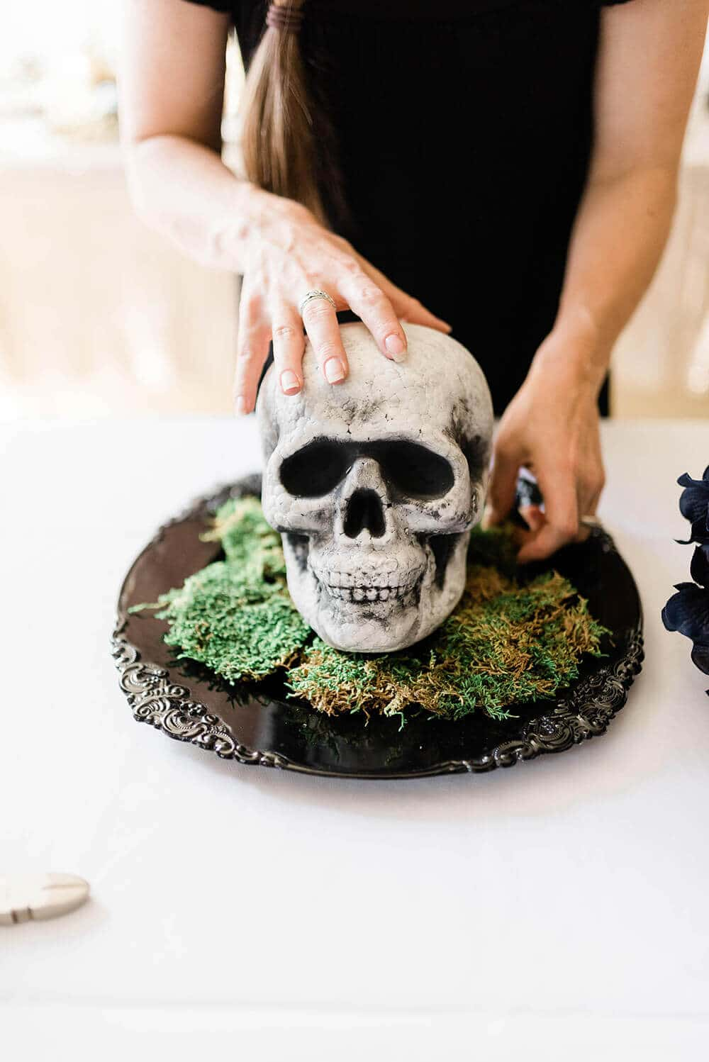 Place skull on bed of moss for centerpiece