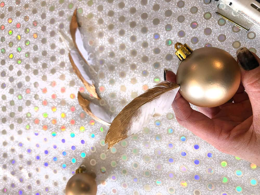 Adding feather wings to Golden snitch ornament