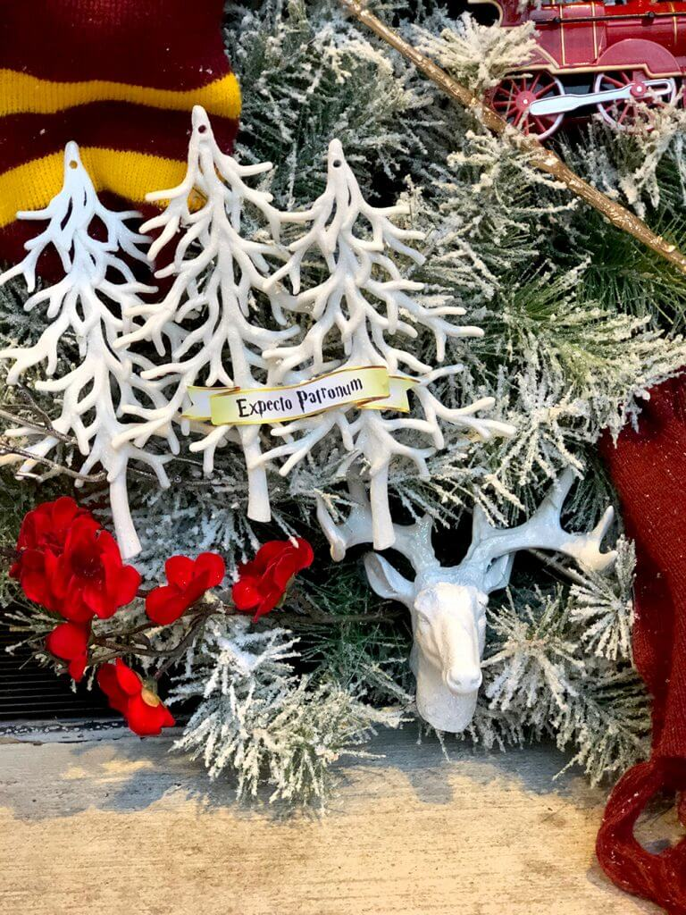 White stag ornament in frosty forest on Christmas wreath