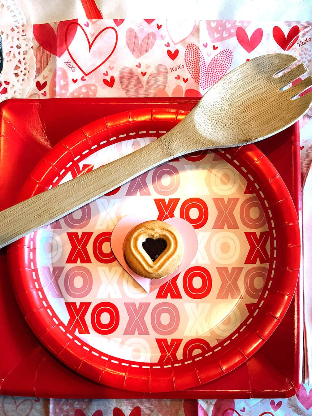 Wooden spoon at Valentine place setting
