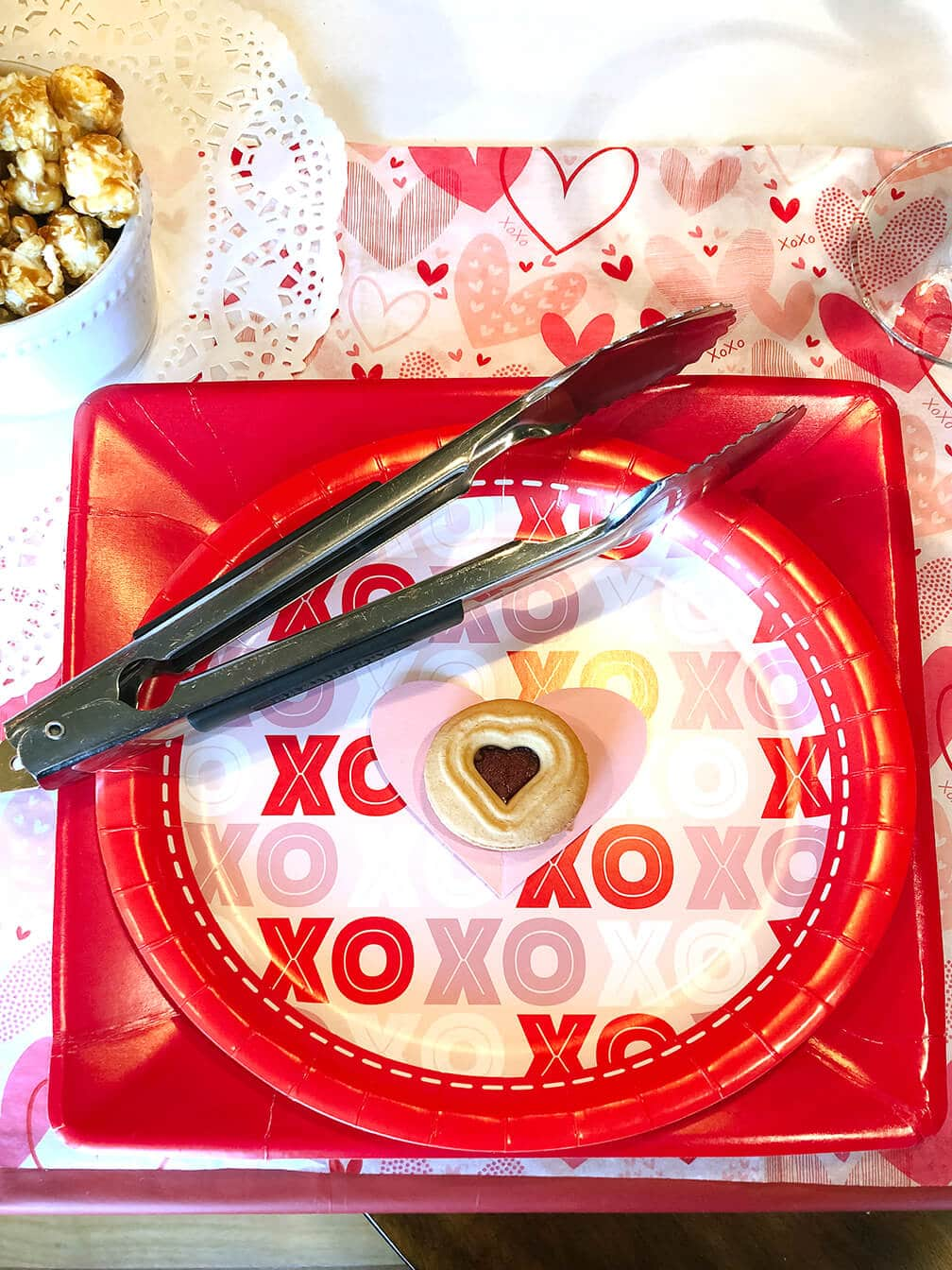 Metal tongs at Valentine place setting