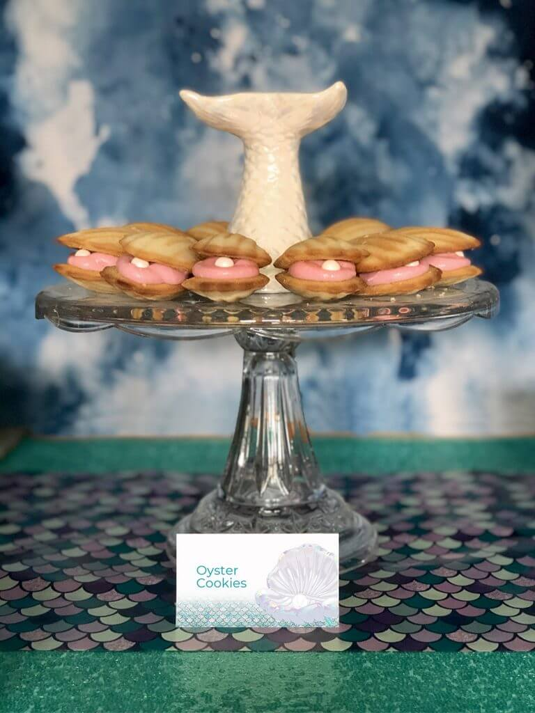 Clam shell cookies o cake stand with mermaid tail by Salt Lake Party Stylist