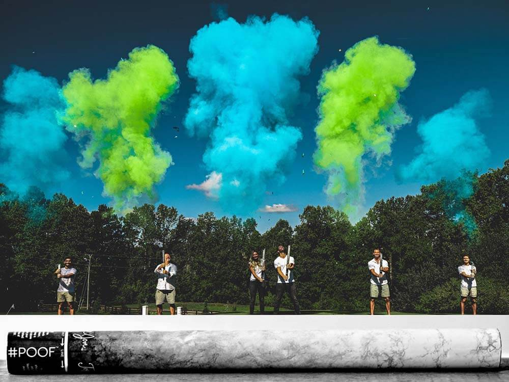 Plumes of green and blue power from cannons to celebrate