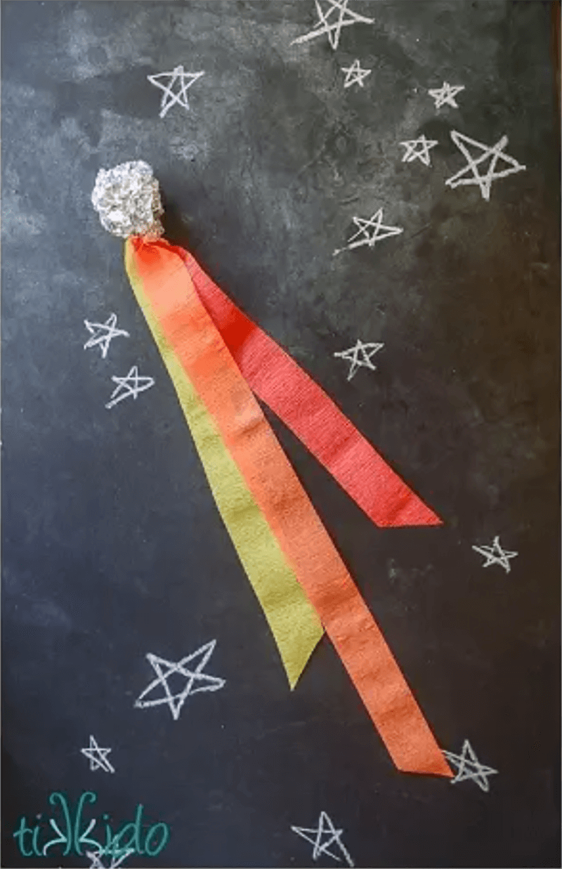 Make your own comet space craft for kids - with log tissue paper tails