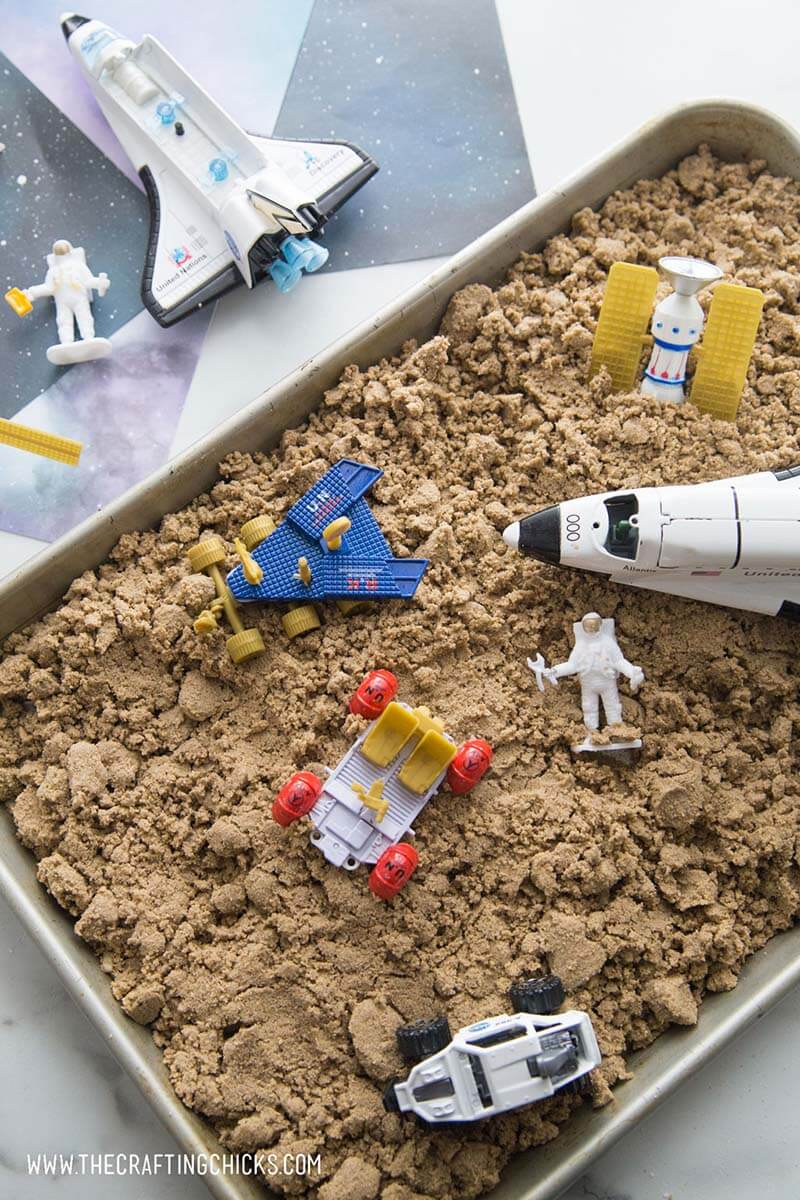 Moon sand on tray with space toys - great space activity