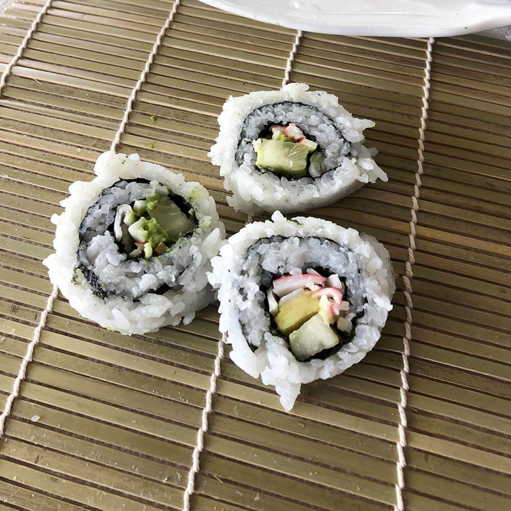 California roll pieces on mat