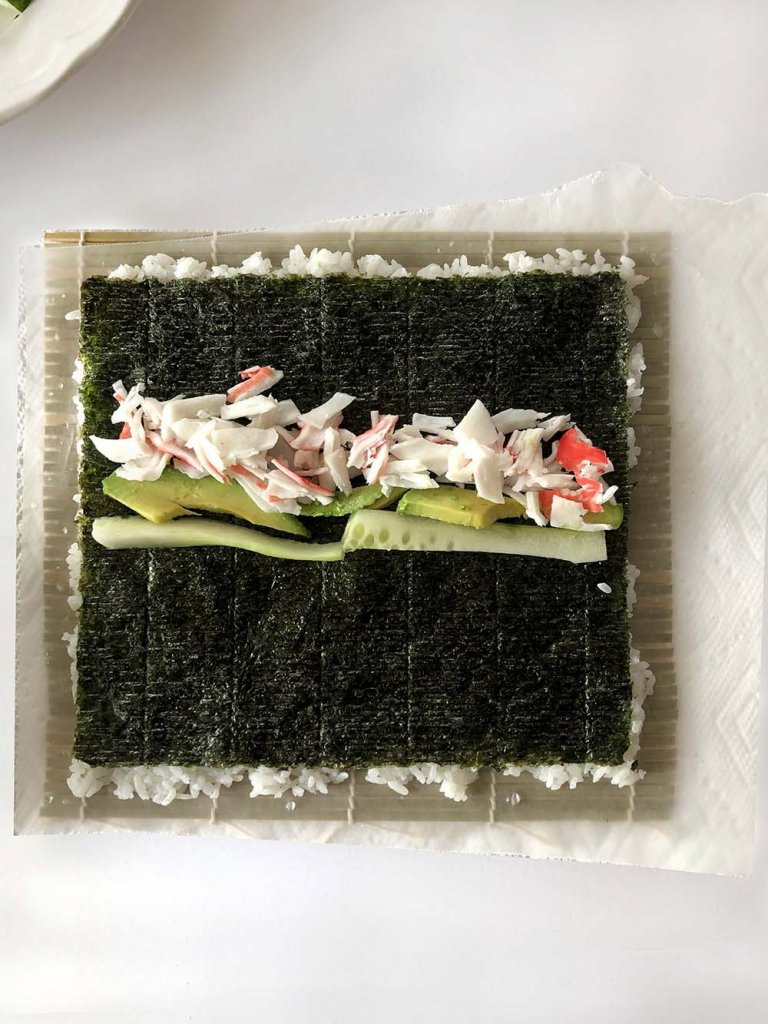 rolling sushi at home - California roll filling on seaweed