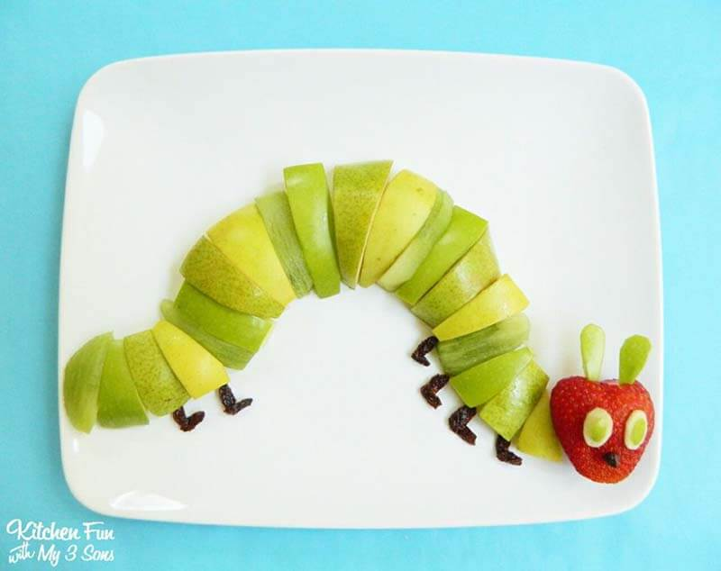 Hungry caterpillar on white plate made from fruit