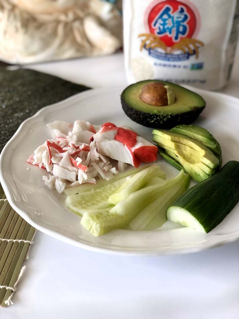 California Roll ingredients on white plate for homemade sushi