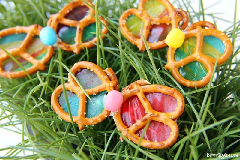 Pretzel butterflies with fruit leather on grass