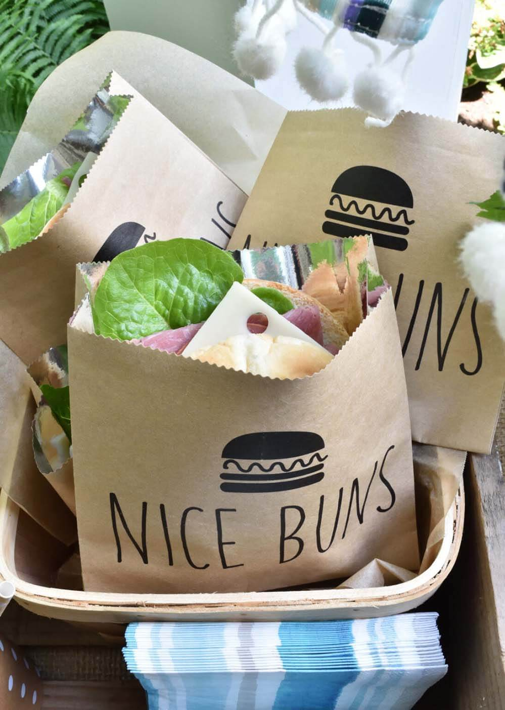 """Sandwiches in paper sacks that read """"nice buns"""""""
