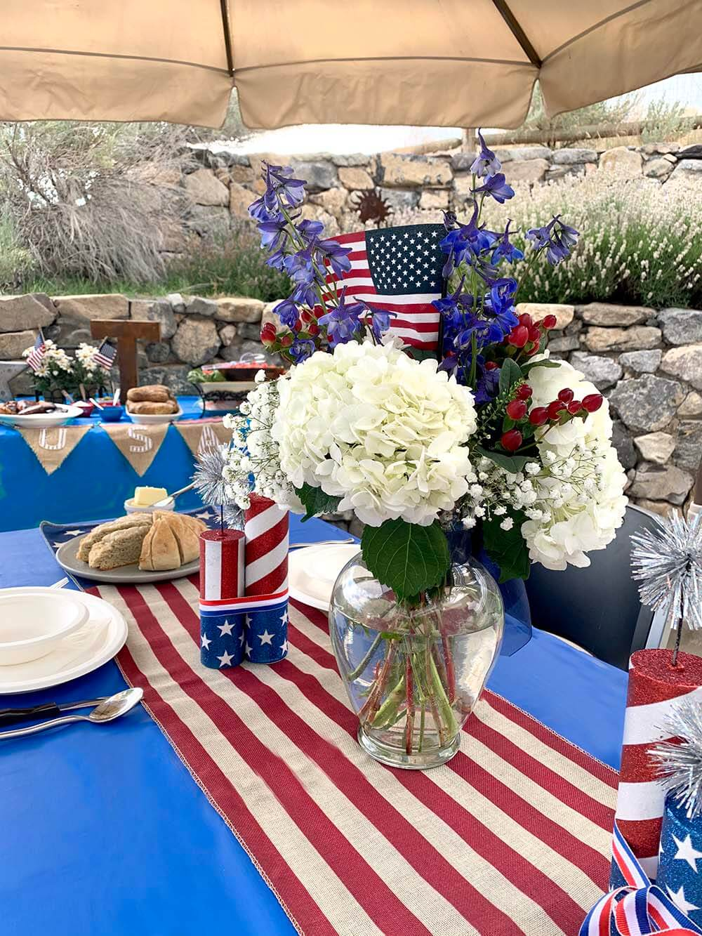 Patriotic tablescape with spread out seating for safe social distanced BBQ