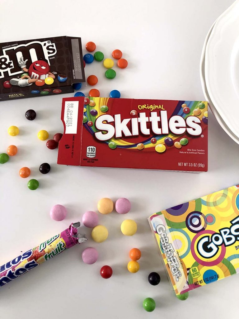 M7Ms, Gobstoppers, Mentos, and Skittles Rainbow experiment on table