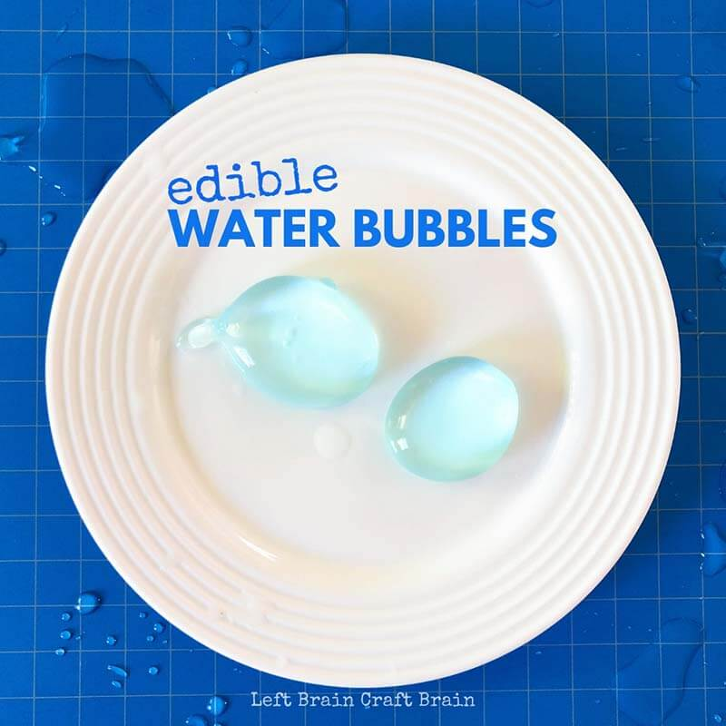 Edible water bubbles on white plate