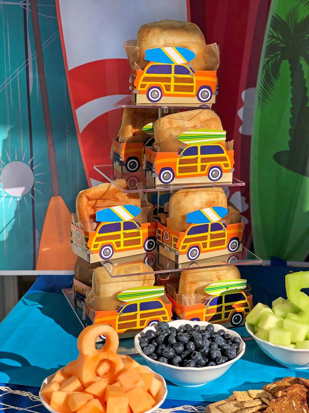 Stacked woody car boxes with sandwiches for serving surf party food
