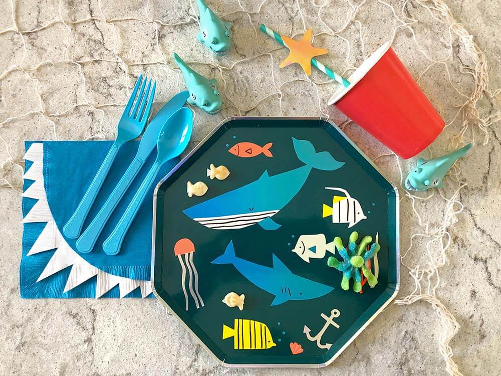Under the sea themed place setting with shark bite napkins