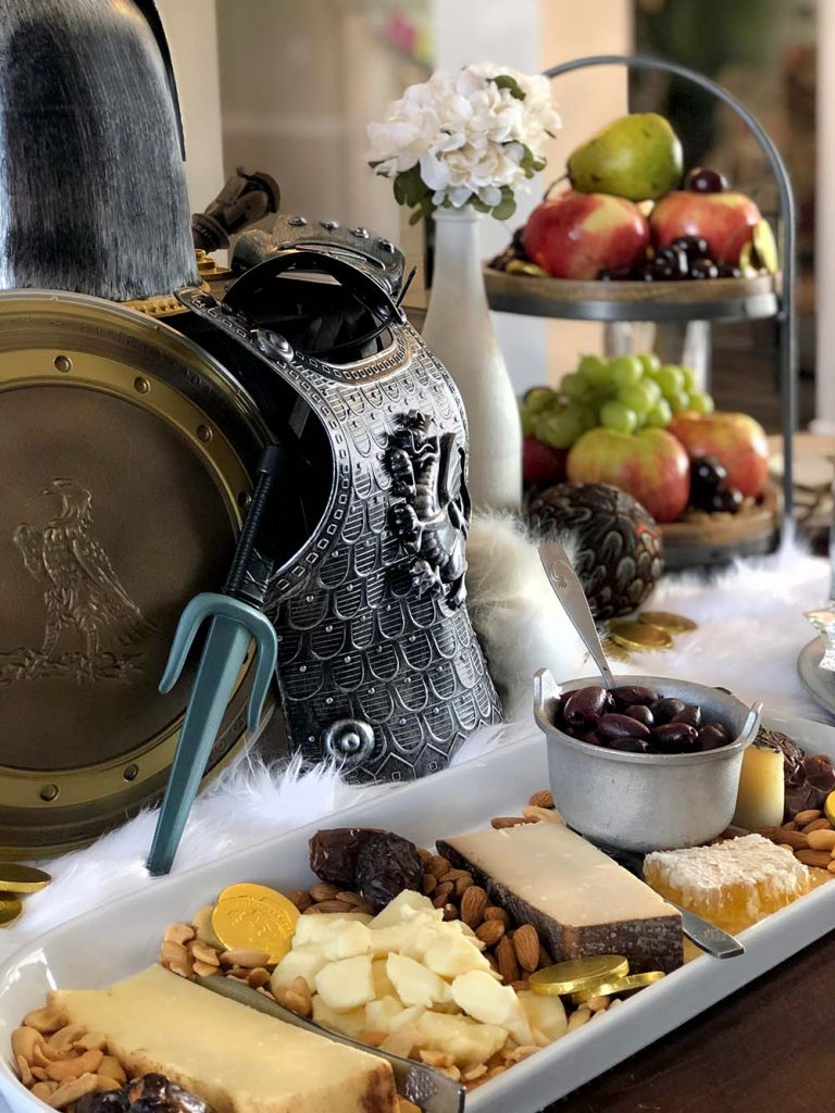 Cheese tray on medieval themed dinner table