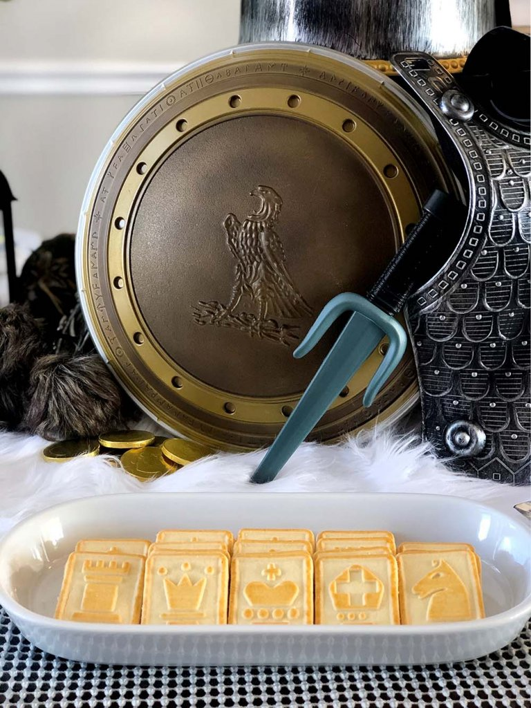 Chessmen shortbread cookies on knight themed dinner table