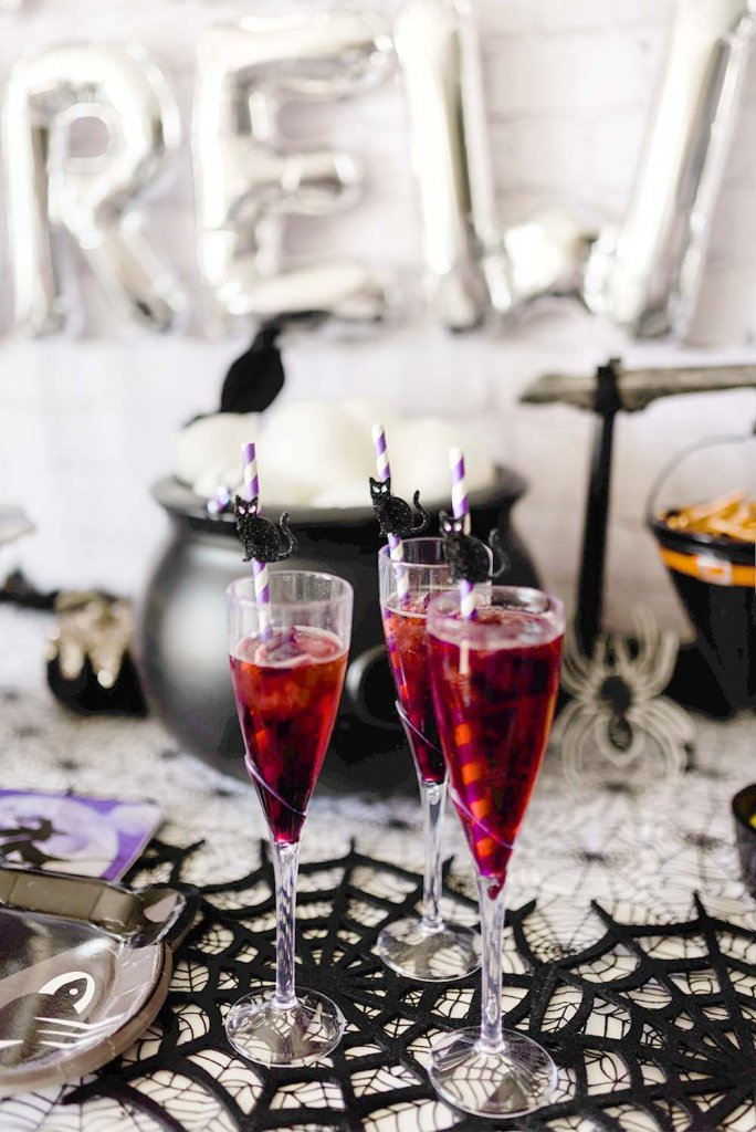 Black Cat Cherry Sparkler in flutes on a Halloween food table