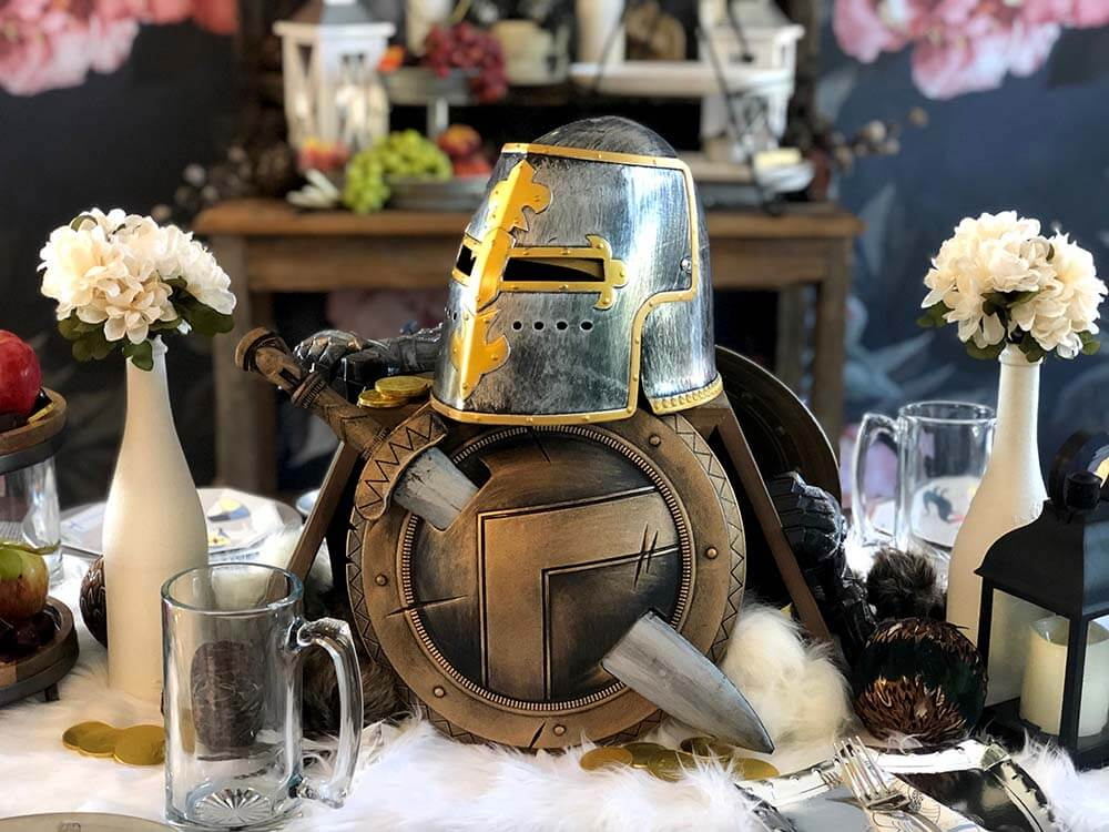 Helmet, shield, and sword centerpiece for a medieval knight party