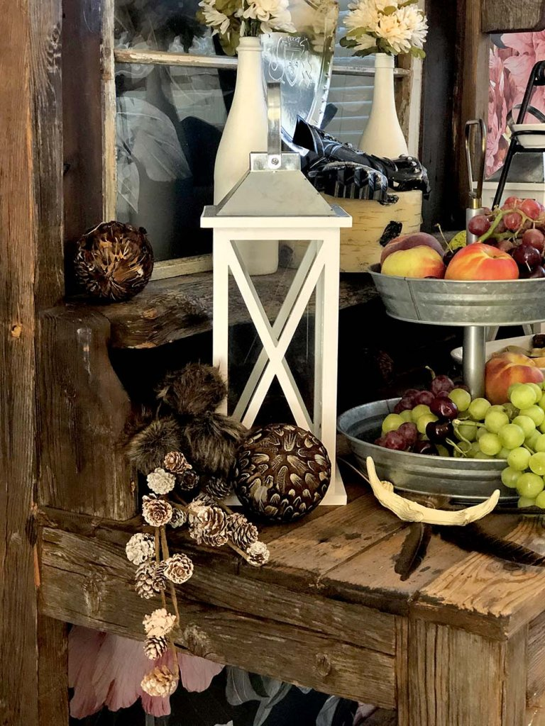 Lantern, fruit, and rustic decor for a medieval feast