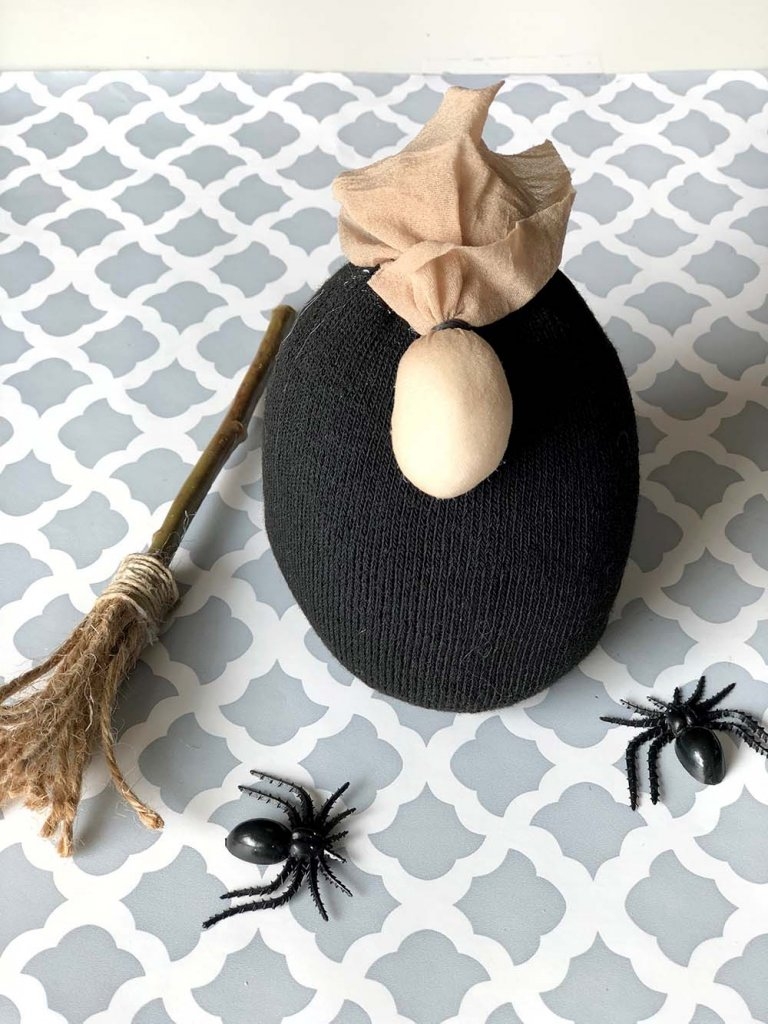 Pantyhose witch nose on sock gnome