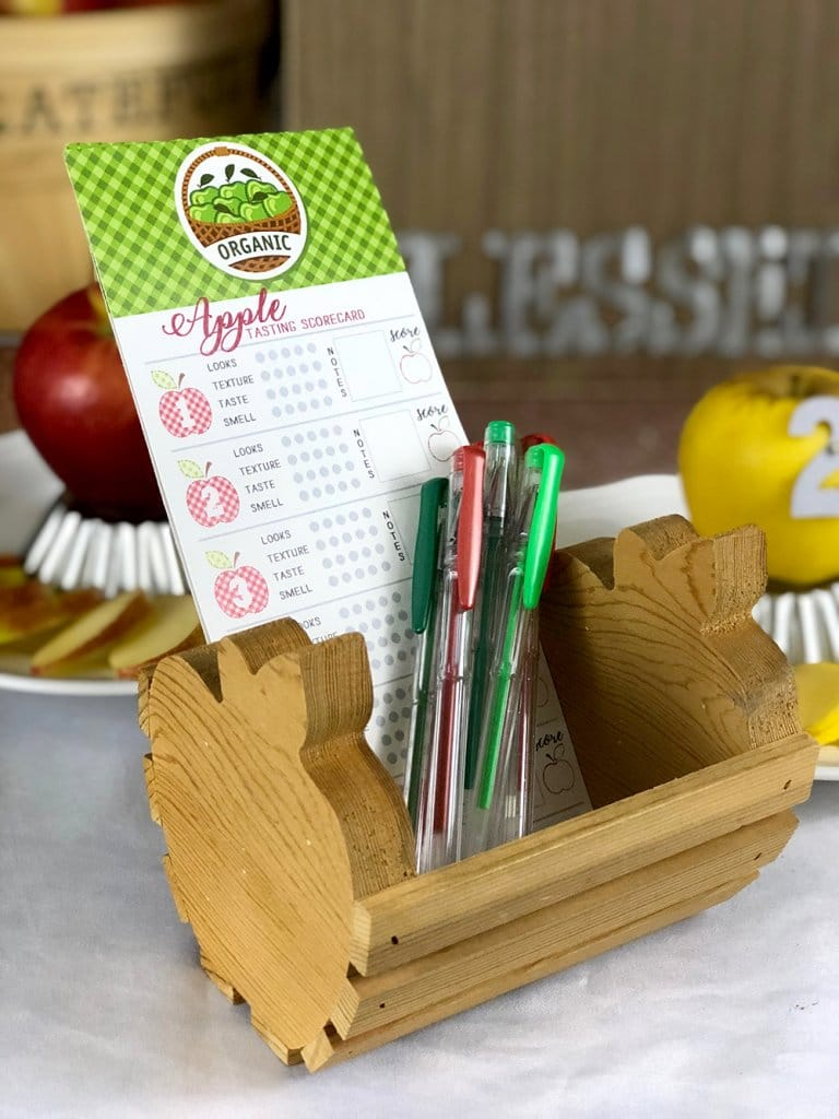 Apple tasting scorecard and pens in little apple basket