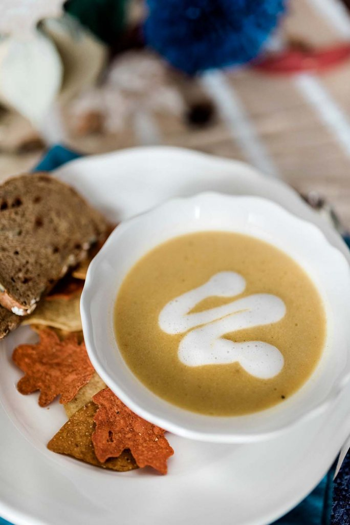 Butternut squash soup topped with coconut cream drizzle