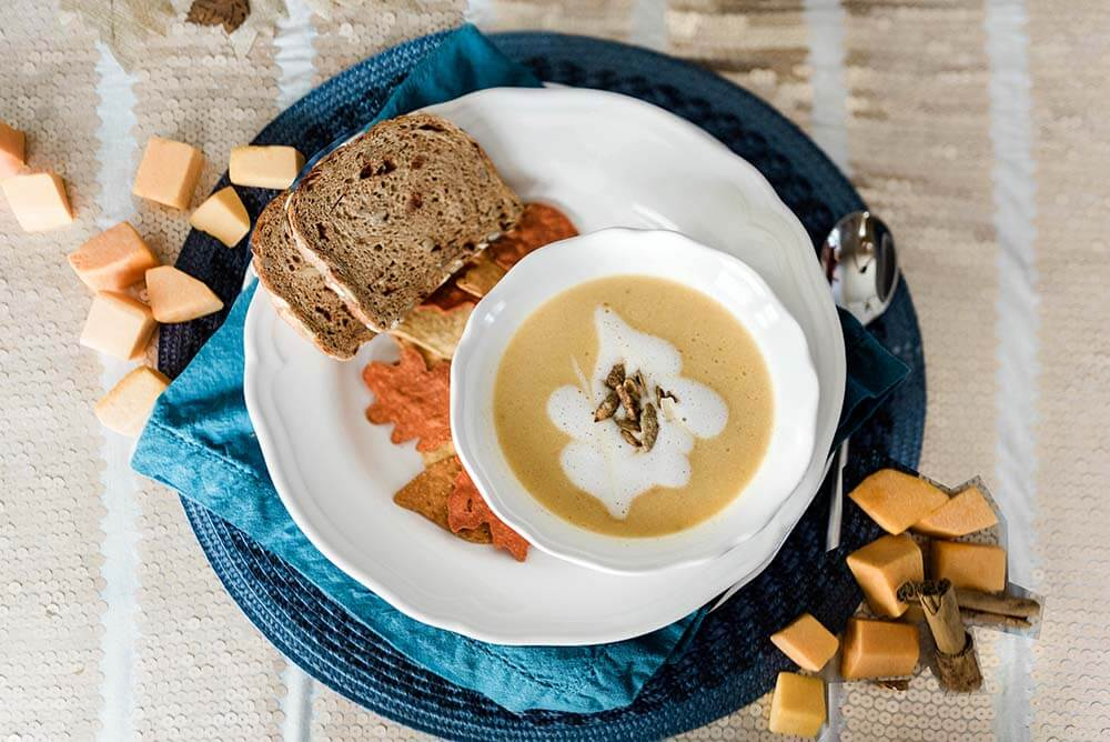 Butternut squash soup recipe served in bowl on fancy table