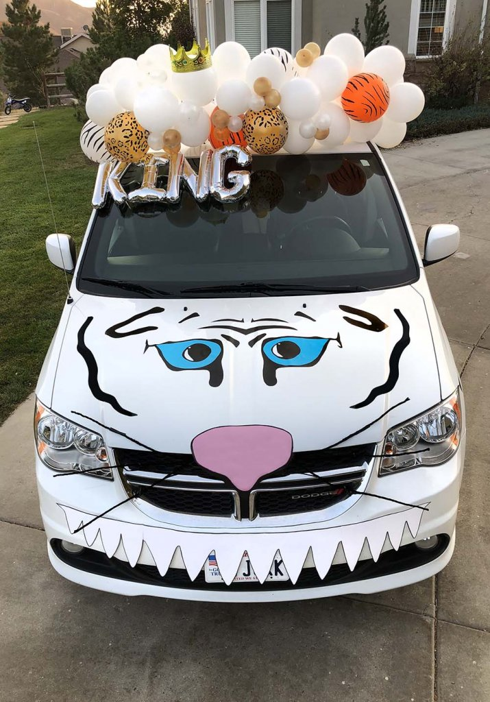 Minivan dressed up like white tiger king Halloween Car Decorating Ideas