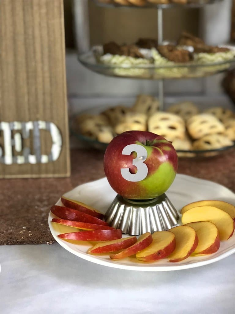 A McIntosh apple sliced on display for apple tasting fall family activity by Salt Lake Party Stylist