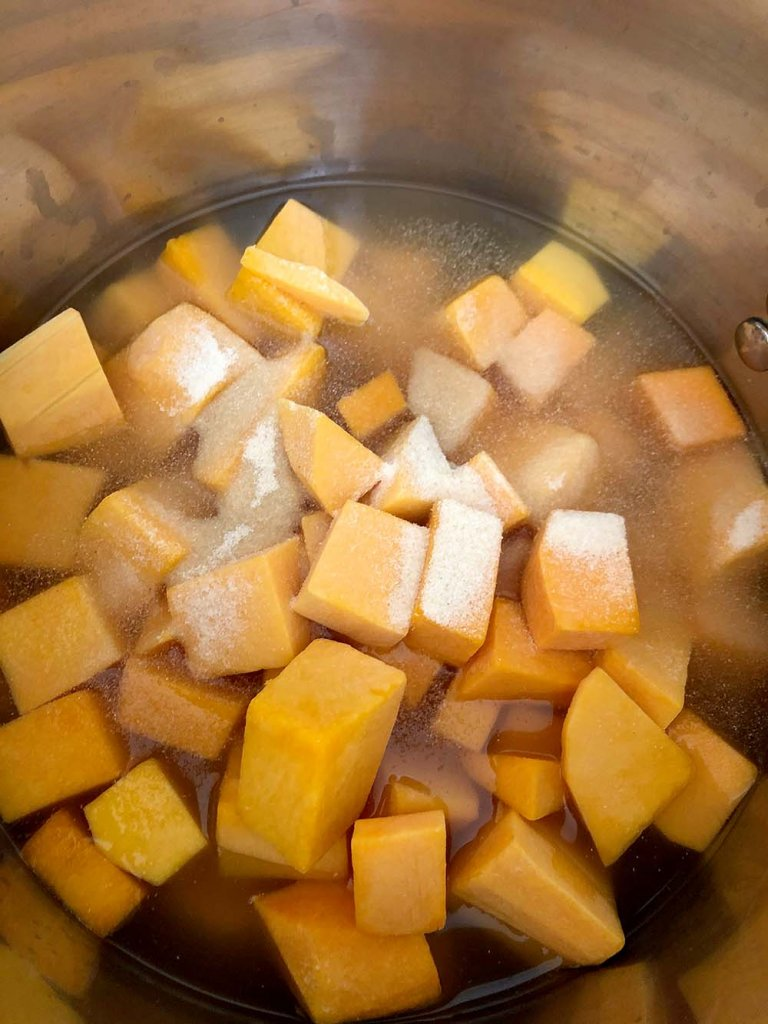 Cubed butternut squash on stove to make soup