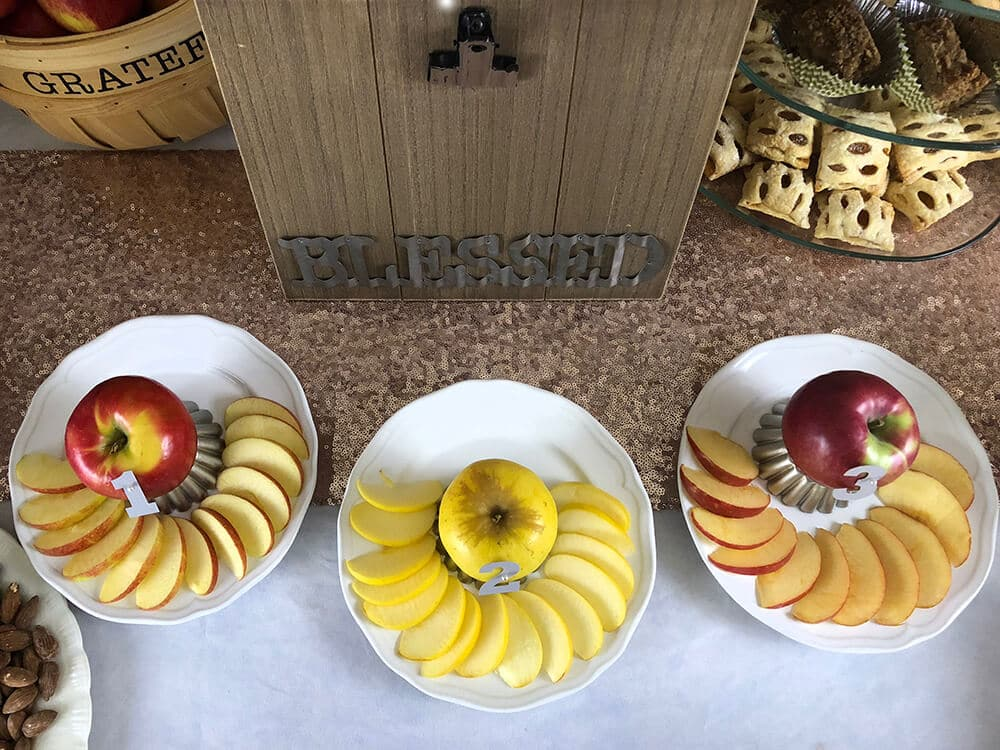 Sliced apples on plates for fall family activity