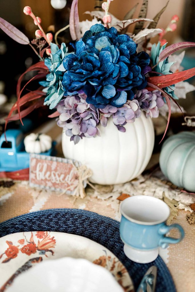 Pumpkin floral centerpiece on Thanksgiving table
