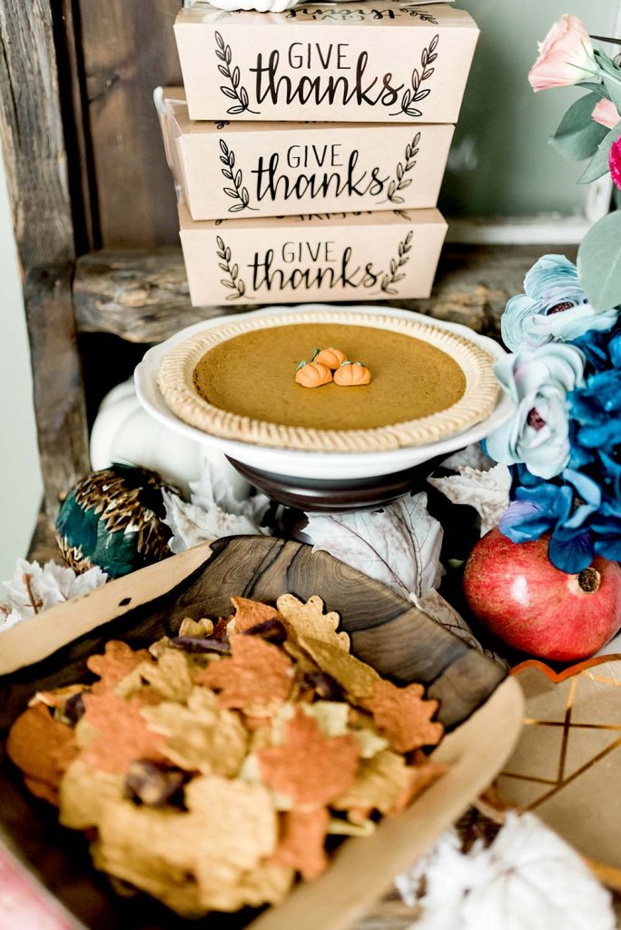 Pumpkin pie and leaf shaped corn chips on food table