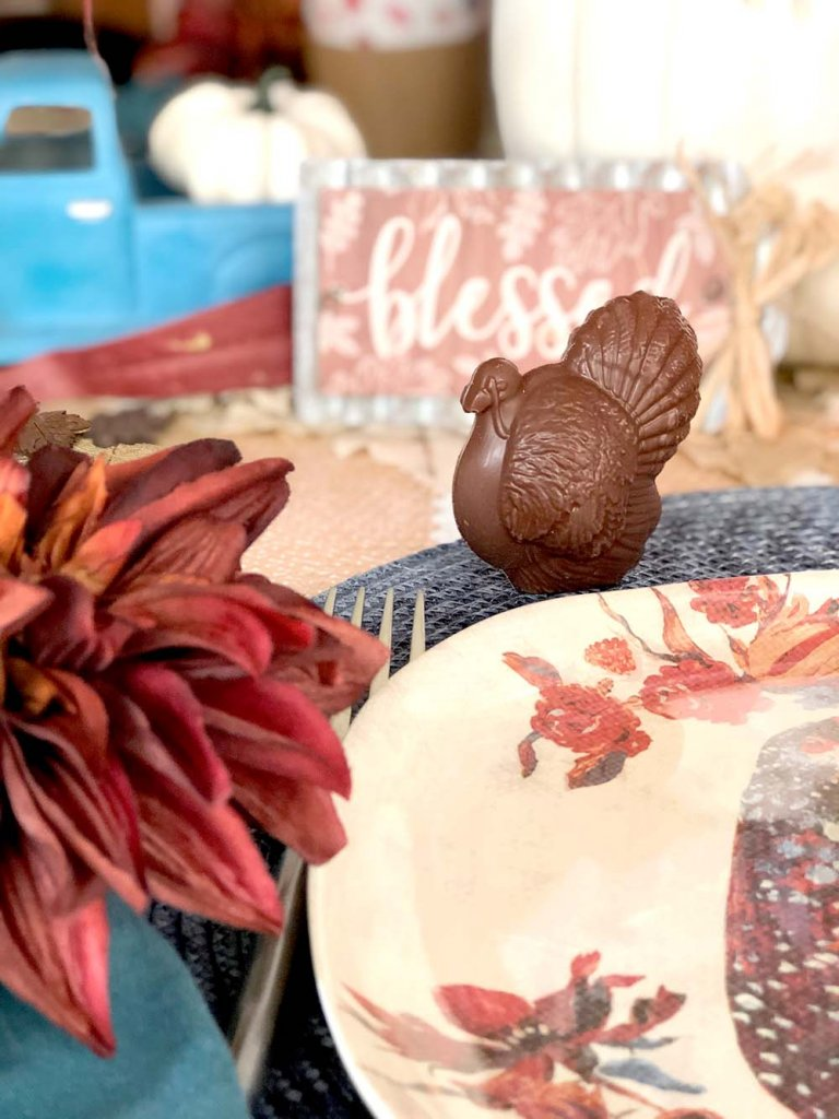 Chocolate turkey at a placesetting on a Thanksgiving table