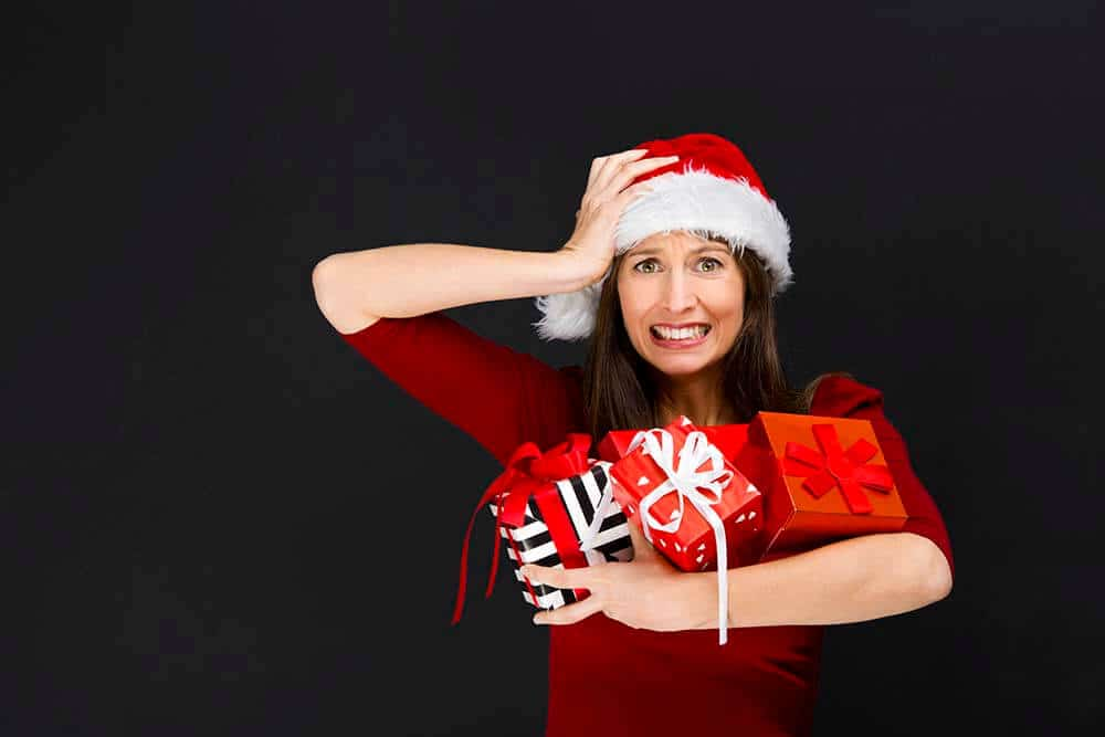 Woman in Santa hat full of Holiday stress