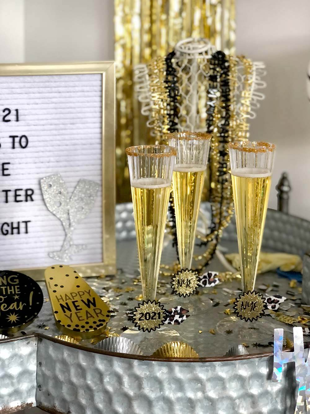 Martinelli's flutes with sugared rims for a family friendly new years eve party
