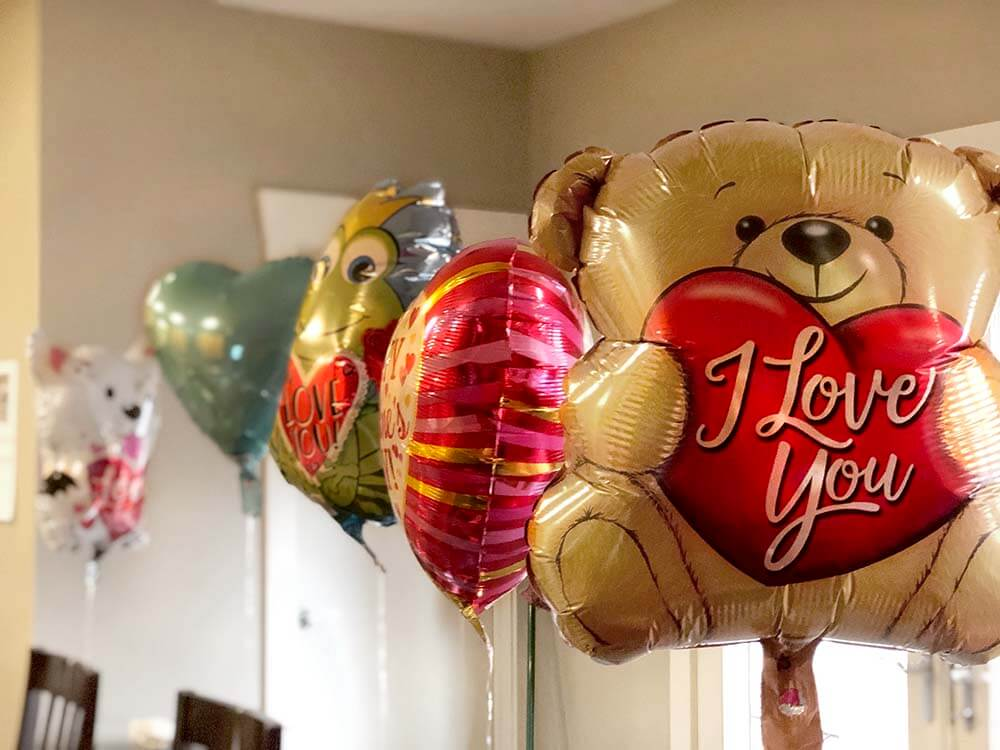 Valentine's balloons tied to the back of each chair