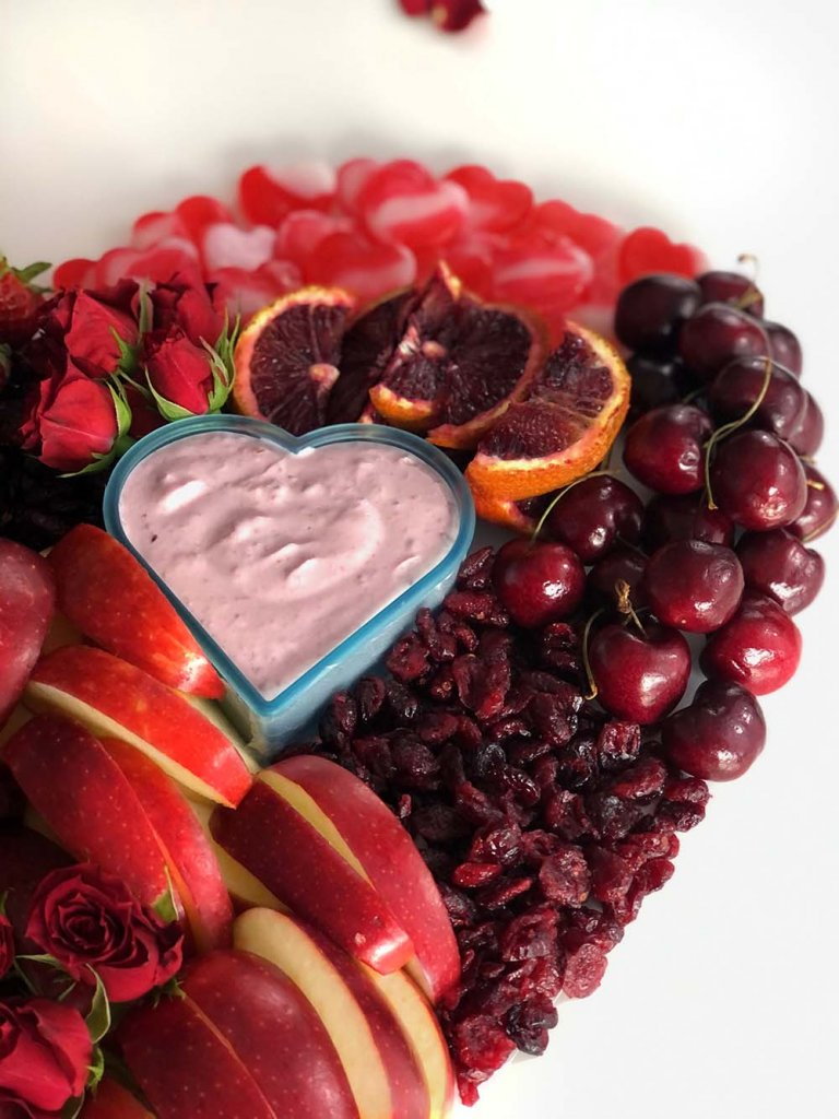 Raspberry yogurt fruit dip in heart shaped cookie cutter