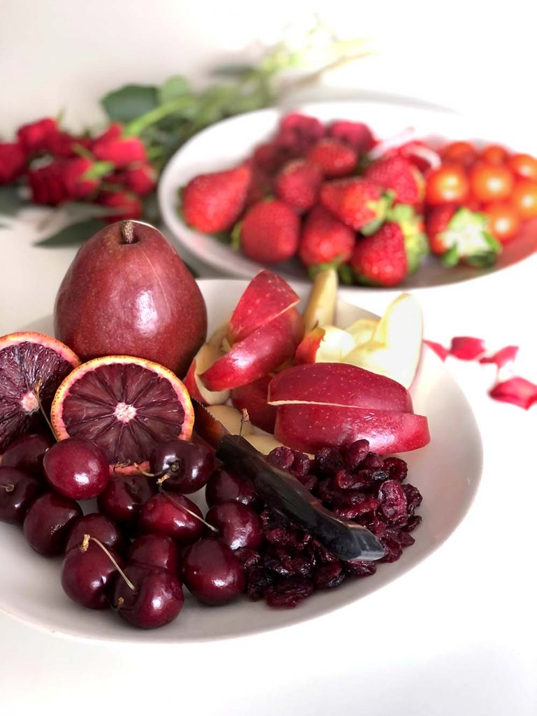 Red fruit on plates for Valentine's Day