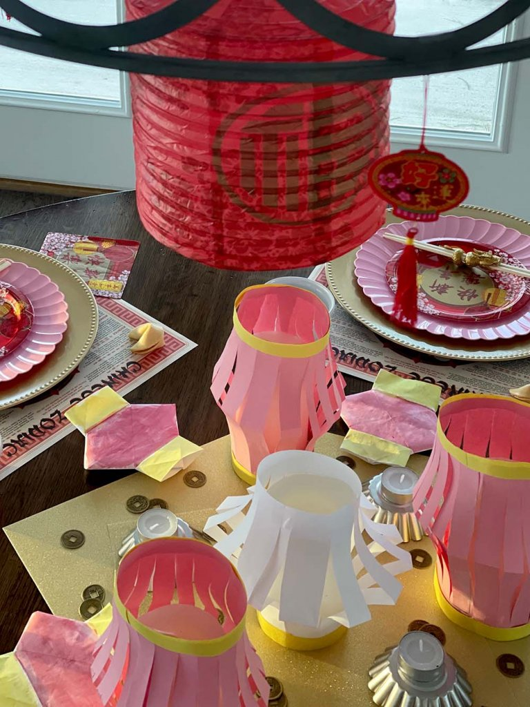 Table set for Chinese New year in red, pink, and gold