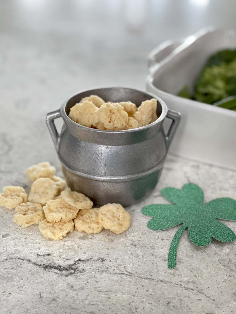 Baked cheese coins in silver pot for St Patrick's Day food
