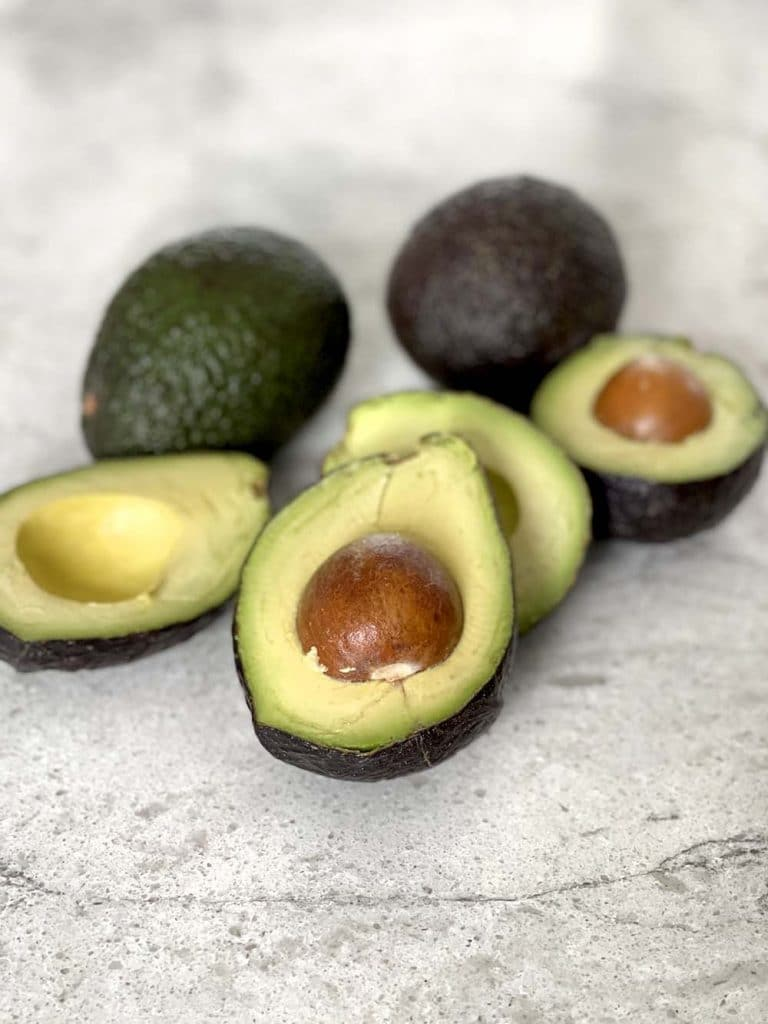 Avocados cut in half on counter
