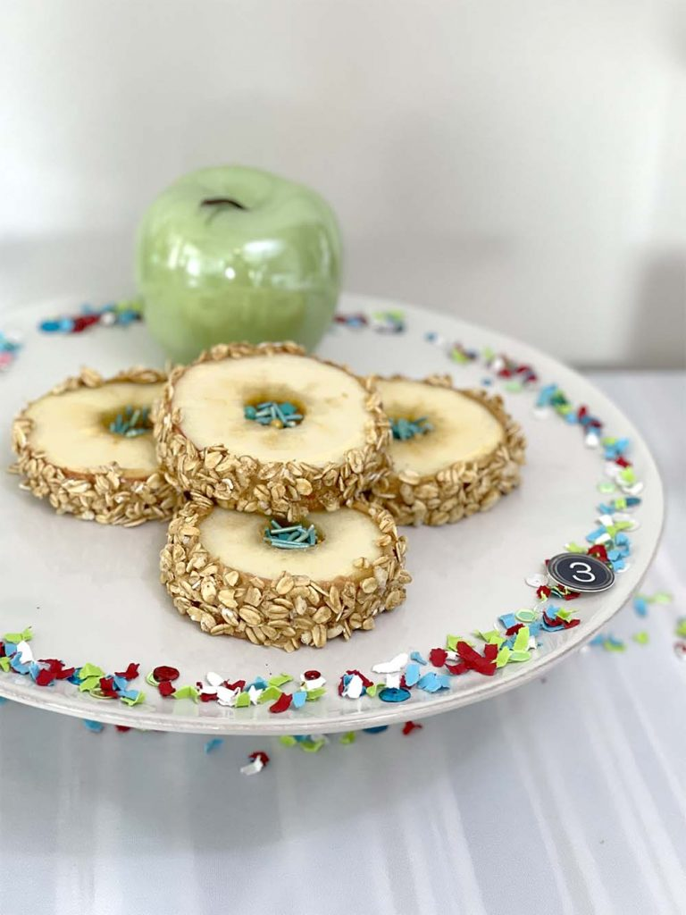 Finished apple sandwiches on white platter for back to school party