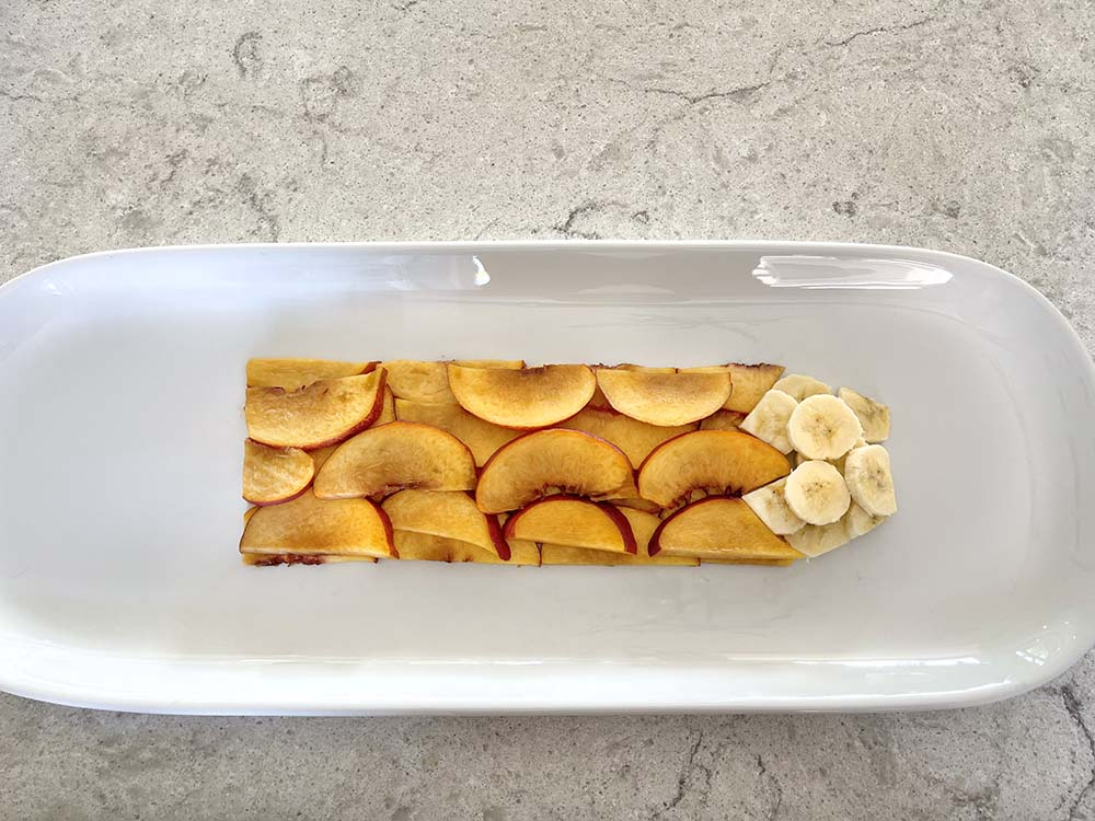 Nectarines and bananas on tray sliced for fruit art