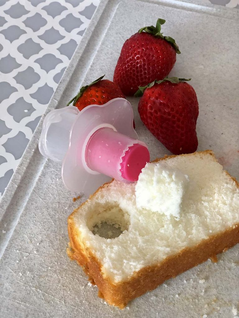 Slice of angel food cake and strawberries for mushrooms