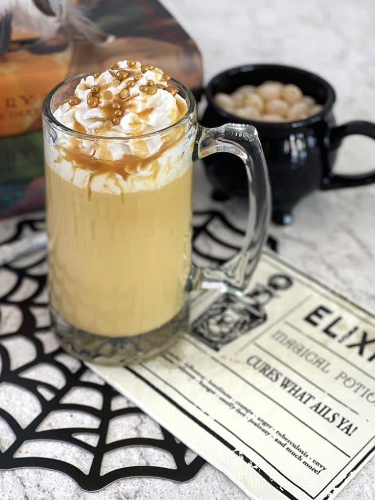 Hot butterbeer in mug with whipped cream