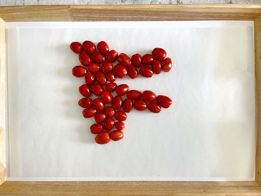 Creating a dragon with grape tomatoes on tray