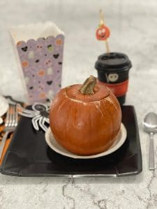 A baked pumpkin filled with dinner for Halloween